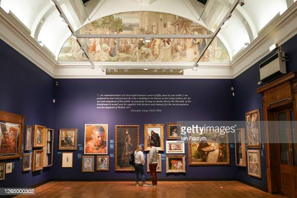 Couple view paintings as the Laing Art Gallery re-opens to the public on August 10, 2020 in Newcastle upon Tyne, England. As Coronavirus pandemic...