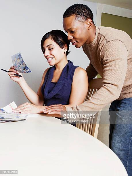 Couple viewing coupons together