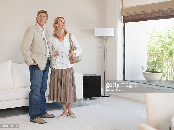 Couple viewing home for sale