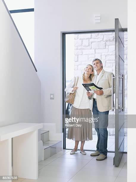 couple viewing home for sale - model home stock pictures, royalty-free photos & images