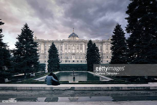 a couple viewing the real palace of madrid (spain) - madrid royal palace stock pictures, royalty-free photos & images