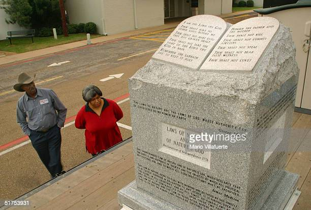A couple views the granite Ten Commandments monument that was removed in 2003 from the Alabama Judicial Building November 16 2004 in Longview Texas...