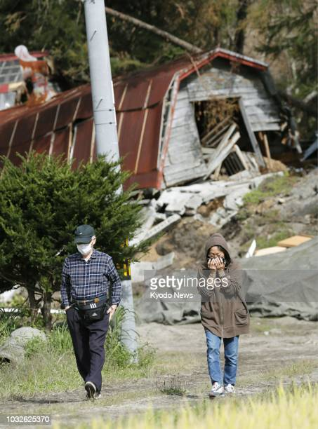 A couple visit a heavily damaged residential area of Atsuma Hokkaido on Sept 13 one week after a strong earthquake struck Japan's northernmost main...