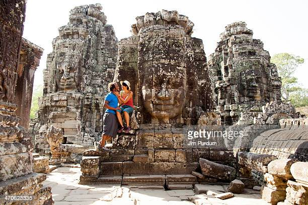 couple visiting ancient temple, angkor, siem reap, cambodia - old ruin stock pictures, royalty-free photos & images