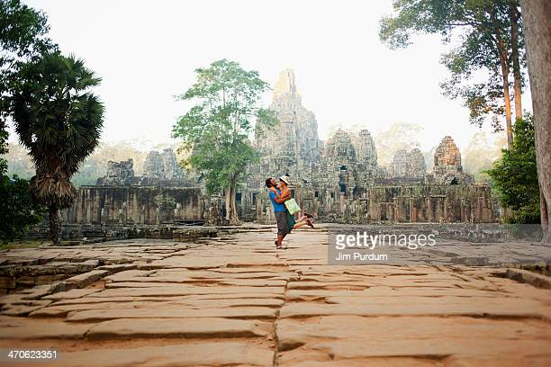 couple visiting ancient temple, angkor, siem reap, cambodia - historical romance stock photos and pictures