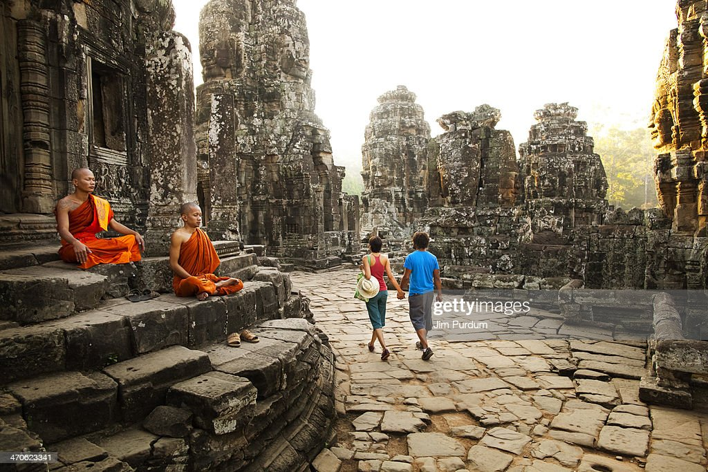 Couple visiting Buddhist temple, Angkor, Siem Reap, Cambodia : Stock Photo