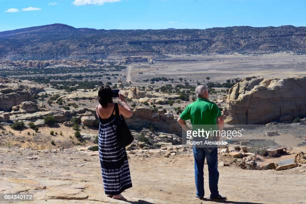 A couple visiting from Bath England admire the view from Sky City one of three Native American villages which make up Acoma Pueblo west of...