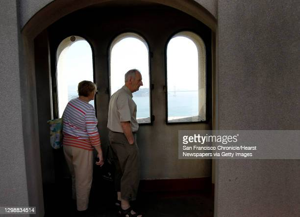 Couple visiting from Ireland check out the views from the top of Coit Tower. The murals which adorn the inside of Coit Tower in San Francisco,...