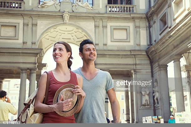 couple visiting uffizi gallery, florence, tuscany, italy - florence italy stock pictures, royalty-free photos & images