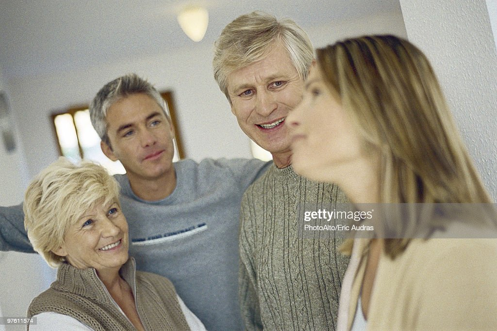 Couple visiting with in-laws : Stock Photo