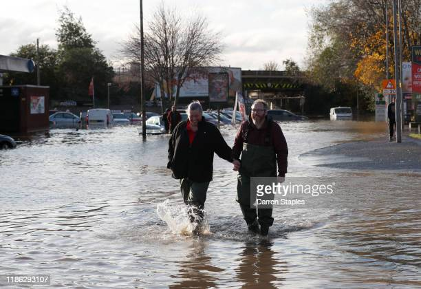 A couple wade through flood waters after the River Don burst its banks on November 08 2019 in Rotherham United Kingdom Parts of northern England...
