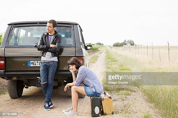 Couple waiting by suv