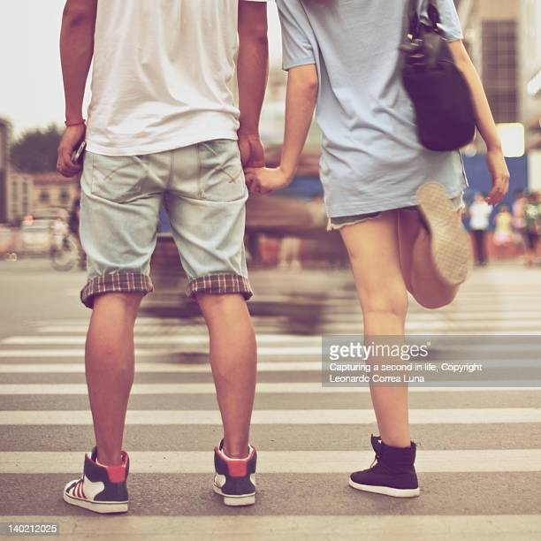 Couple waiting for crosswalk