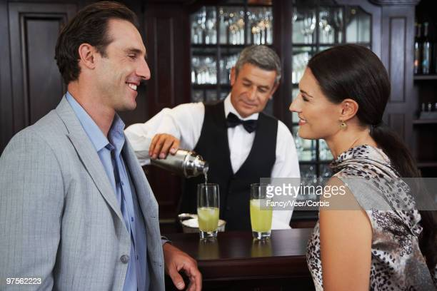 Couple waiting for drink at bar