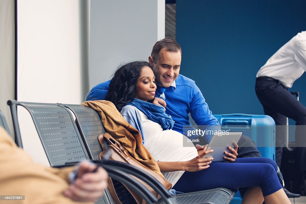 Couple waiting for flight : Stock Photo