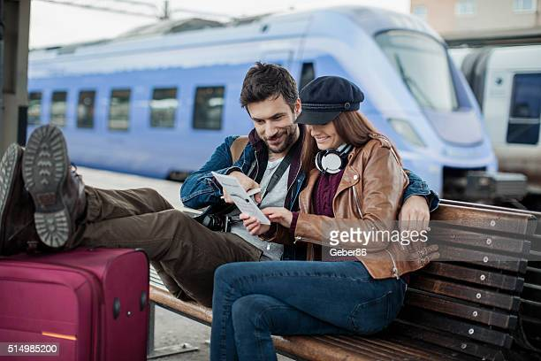 Couple waiting for train
