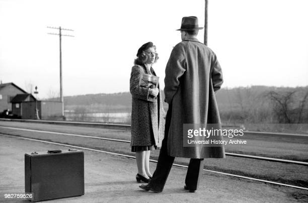 Couple Waiting for Train to Minneapolis East Dubuque Illinois USA John Vachon for Farm Security Administration April 1940