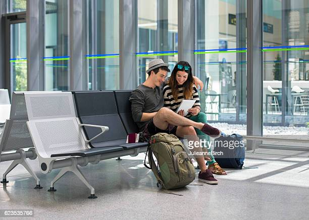 Couple waiting in airport terminal