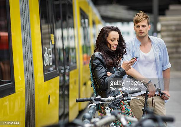 couple waiting on a streetcar - tram stockfoto's en -beelden