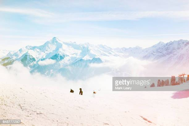 A couple waiting to start skiing on a spring-like day in Mayrhofen, Austria