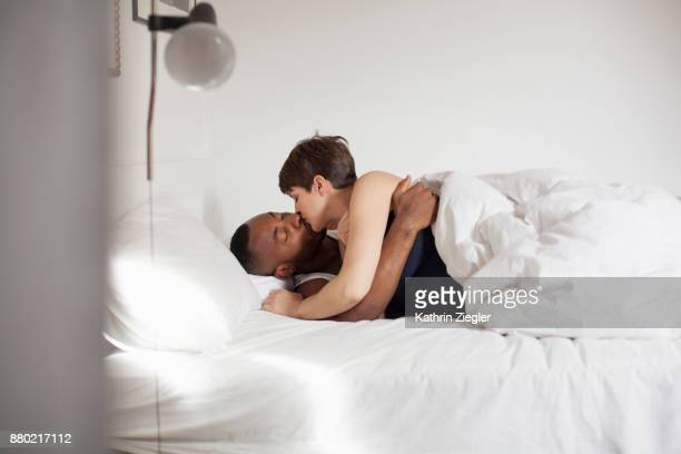 Couple waking up together, kissing