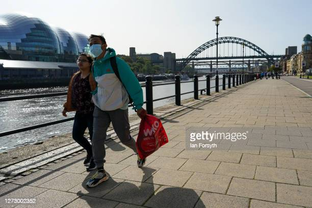 A couple walk along Newcastle quayside on September 17 2020 in Newcastle upon Tyne England Almost two million people in northeast England will be...