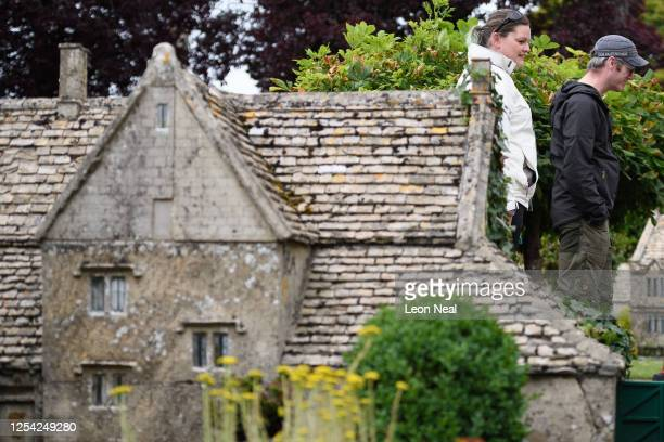 Couple walk along one of the miniature streets of the model village on July 04, 2020 in Bourton-on-the-Water, England. Model villages are among the...