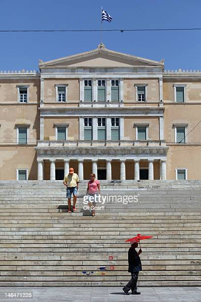 Couple walk down the steps into Syntagma Square in front of the Parliament building ahead of the result of the general election on June 17, 2012 in...