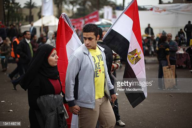 A couple walk in Tahrir Square on November 27 2011 in Cairo Egypt Protestors are continuing to occupy Tahrir Square ahead of parliamentary elections...