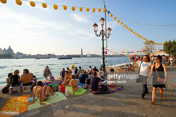 A couple walk on Giudecca during the Redentore Celebrations on July 20 2013 in Venice Italy Redentore is one of the most loved celebrations by...