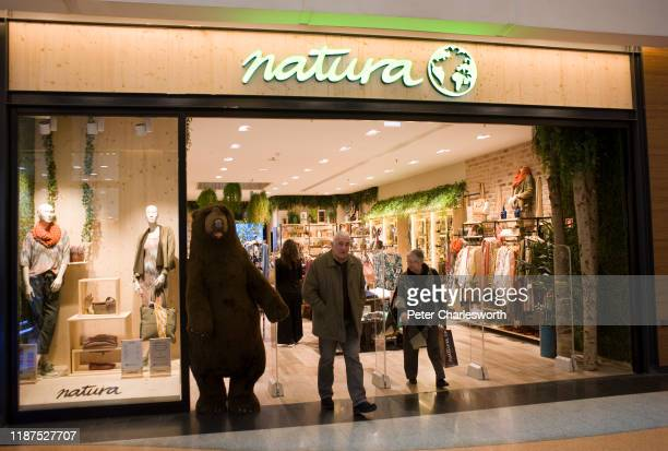 Couple walk out of a Natura shop that sells clothing in the Forum shopping mall.