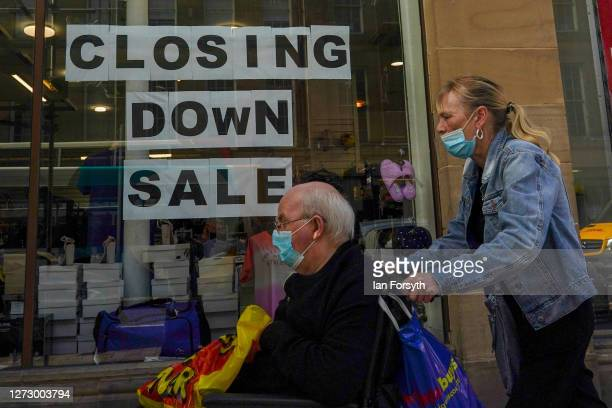 A couple walk past a shop that is closing down in Newcastle city centre on September 17 2020 in Newcastle upon Tyne England Almost two million people...