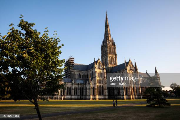 A couple walk past Salisbury Cathedral as the sun sets on July 4 2018 in Salisbury England A man and woman in their 40s are in a critical condition...