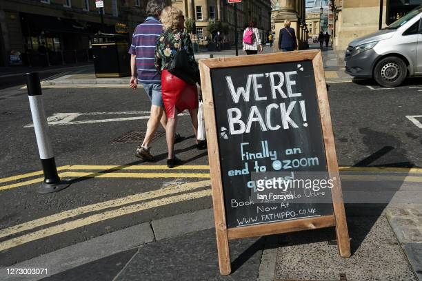 A couple walk past sign advertising a restaurant on September 17 2020 in Newcastle upon Tyne England Almost two million people in northeast England...