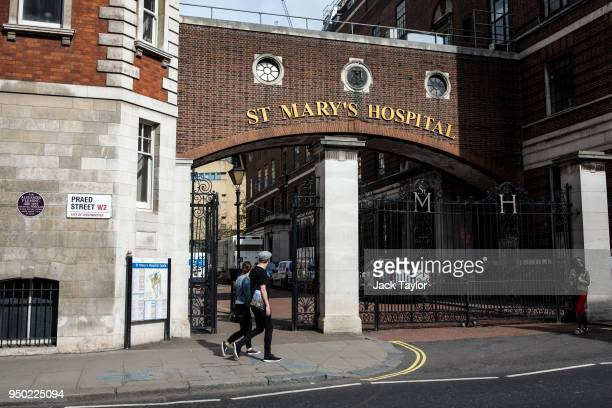 Couple walk past St Mary's Hospital ahead of the birth of the Duke & Duchess of Cambridge's third child on April 23, 2018 in London, England....