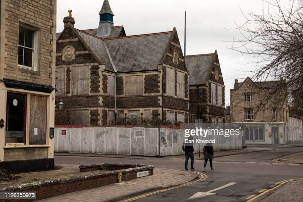 A couple walk past the former Cricketers Pub which sits in an area known as the Railway Village on February 20 2019 in Swindon England The area once...