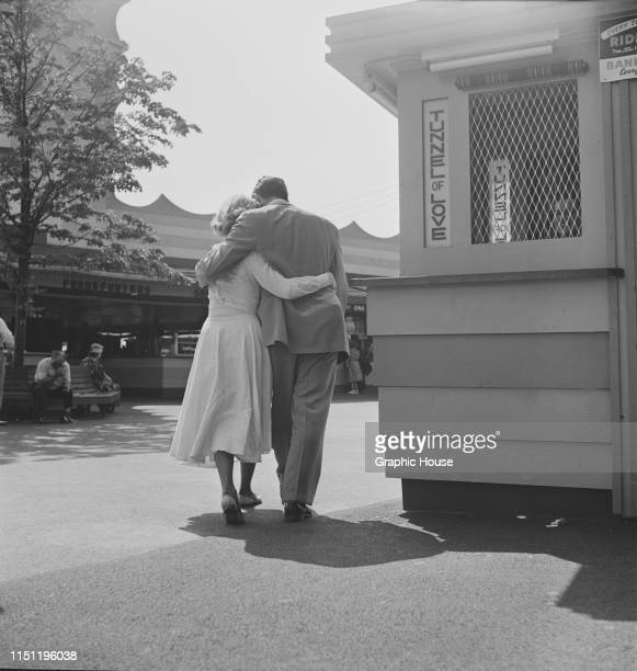 A couple walk past the Tunnel of Love at the Palisades Amusement Park in New Jersey 1949