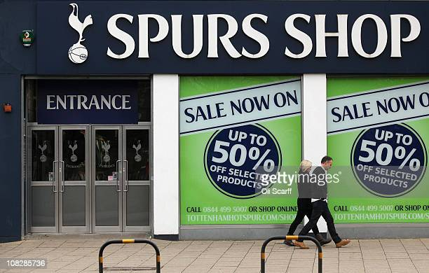 Couple walk past Tottenham Hotspur football club's merchandise shop outside their White Hart Lane stadium in north London on January 24, 2011 in...