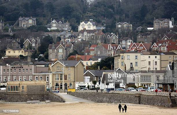 A couple walk with a child on the beach on February 21 2013 in WestonSuperMare England According to recently released figures by the Ministry Of...