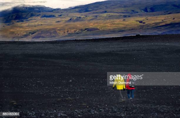 Couple Walking across a Desert Landscape in Iceland