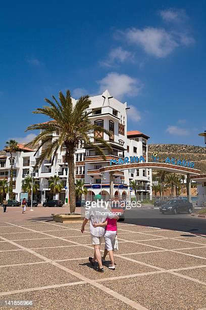 Couple walking along at Agadir Marina, Morocco