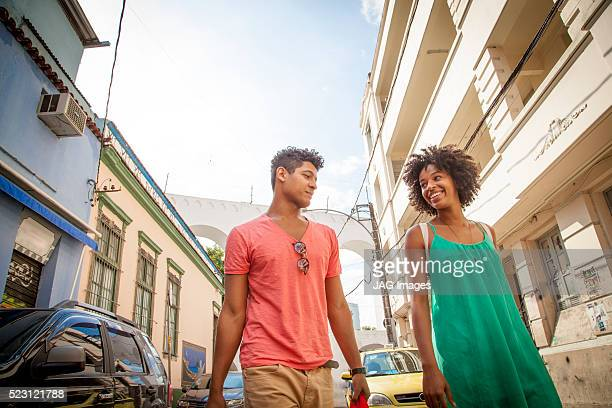 Couple walking and looking at each other in Lapa, Rio de Janeiro, Brazil