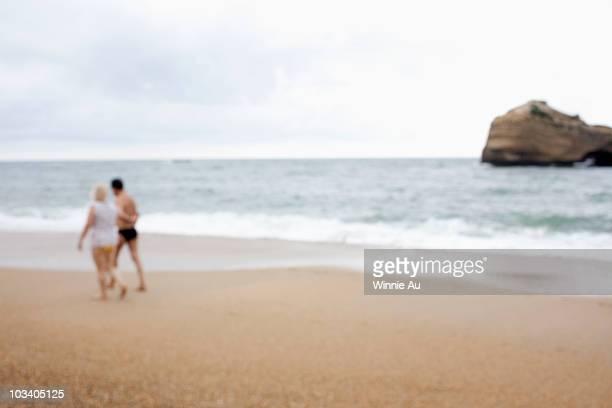 A couple walking at a beach, defocused