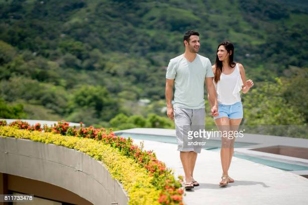 Couple walking at their beautiful hotel in the countryside