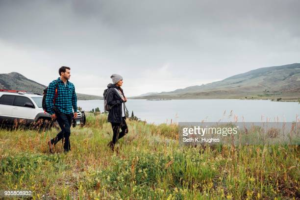 couple walking beside dillon reservoir, silverthorne, colorado, usa - close to stock pictures, royalty-free photos & images