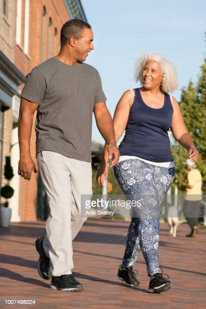 Couple Walking for Fitness in a City