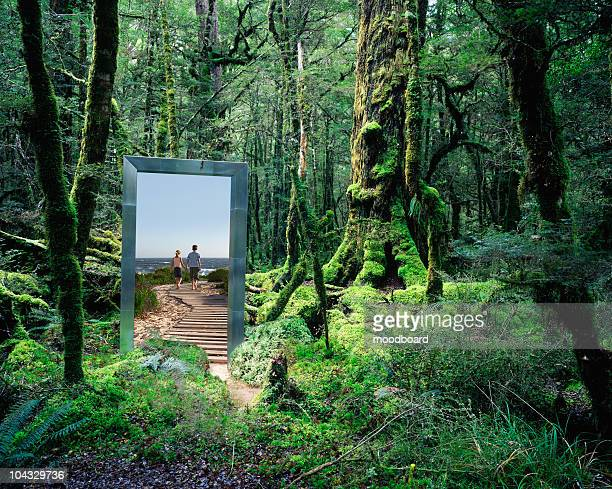 couple walking from rainforest to beach - magic doors stock pictures, royalty-free photos & images