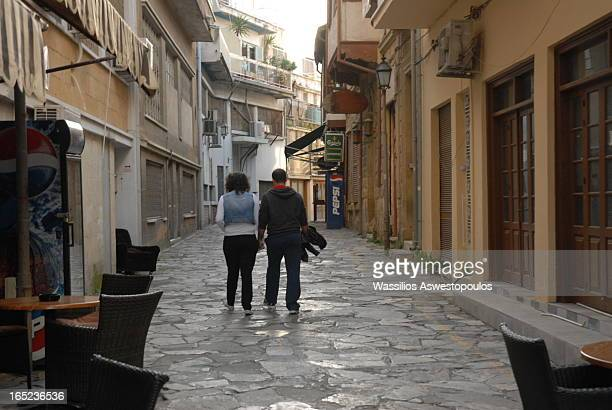 CONTENT] Couple walking in a small alley in Nicosia downtown