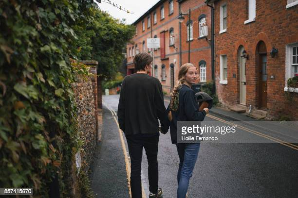 Couple Walking in a Village