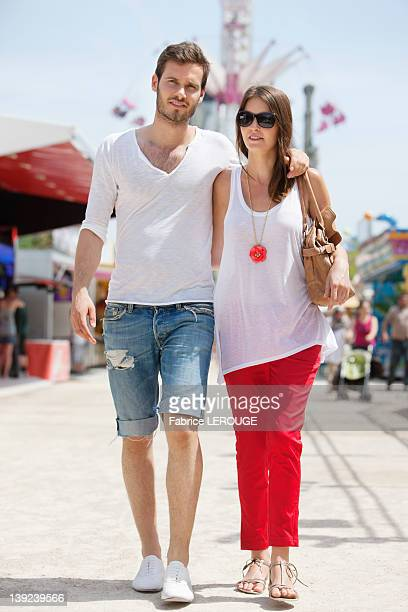 Couple walking in amusement park, Jardin des Tuileries, Paris, Ile-de-France, France